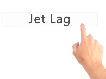 timezone: Jet Lag - Hand pressing a button on blurred background concept . Business, technology, internet concept. Stock Photo