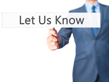 let: Let Us Know - Businessman hand holding sign. Business, technology, internet concept. Stock Photo