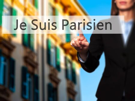 syria peace: Je Suis Parisien ( I am Parisien)  - Businesswoman hand pressing button on touch screen interface. Business, technology, internet concept. Stock Photo
