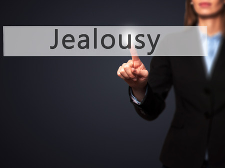 jealousy: Jealousy - Businesswoman hand pressing button on touch screen interface. Business, technology, internet concept. Stock Photo