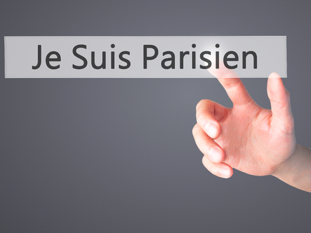 killed: Je Suis Parisien ( I am Parisien)  - Hand pressing a button on blurred background concept . Business, technology, internet concept. Stock Photo Stock Photo