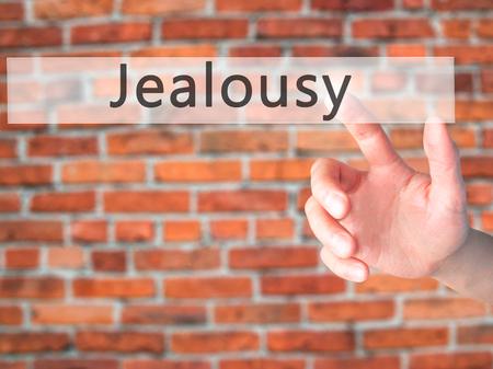 celos: Los celos - Mano presionando un bot�n en concepto de fondo borroso. Negocios, la tecnolog�a, el concepto de internet. Foto de stock