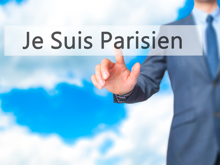 touch screen interface: Je Suis Parisien ( I am Parisien)  - Businessman hand pressing button on touch screen interface. Business, technology, internet concept. Stock Photo