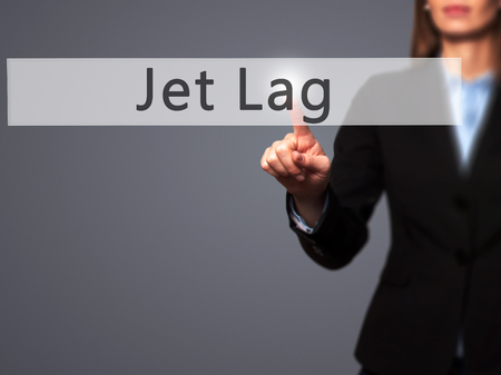 lag: Jet Lag - Businesswoman hand pressing button on touch screen interface. Business, technology, internet concept. Stock Photo