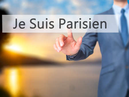syria peace: Je Suis Parisien ( I am Parisien)  - Businessman hand pressing button on touch screen interface. Business, technology, internet concept. Stock Photo