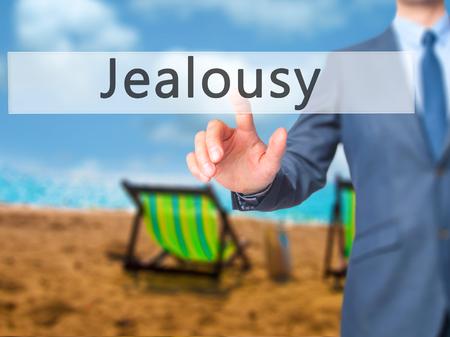 celos: Los celos - Mano de empresario bot�n en la interfaz de pantalla t�ctil de prensado. Negocios, la tecnolog�a, el concepto de internet. Foto de stock