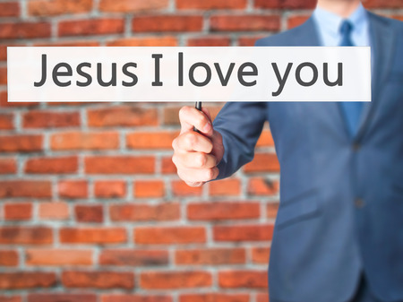 redemption: Jesus I love you - Businessman hand holding sign. Business, technology, internet concept. Stock Photo Stock Photo