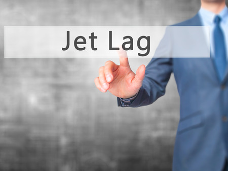 lag: Jet Lag - Businessman hand pressing button on touch screen interface. Business, technology, internet concept. Stock Photo