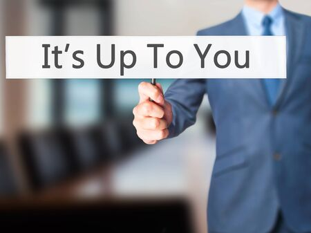achiever: Its Up To You - Businessman hand holding sign. Business, technology, internet concept. Stock Photo