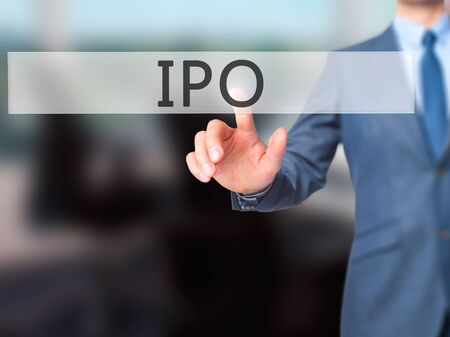 brokerage: IPO - Businessman hand pressing button on touch screen interface. Business, technology, internet concept. Stock Photo