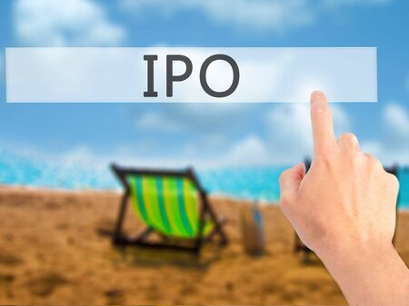 valued: IPO - Hand pressing a button on blurred background concept . Business, technology, internet concept. Stock Photo Stock Photo