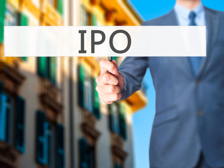 publicly: IPO - Businessman hand holding sign. Business, technology, internet concept. Stock Photo Stock Photo