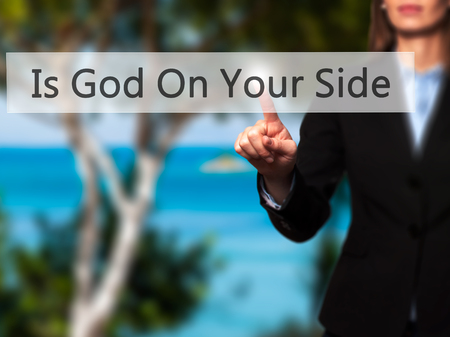 god button: Is God On Your Side - Businesswoman hand pressing button on touch screen interface. Business, technology, internet concept. Stock Photo