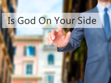 god button: Is God On Your Side - Businessman hand pressing button on touch screen interface. Business, technology, internet concept. Stock Photo Stock Photo