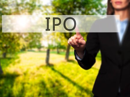 IPO - Businesswoman hand pressing button on touch screen interface. Business, technology, internet concept. Stock Photo