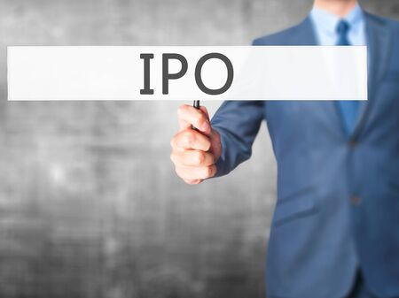 valued: IPO - Businessman hand holding sign. Business, technology, internet concept. Stock Photo Stock Photo