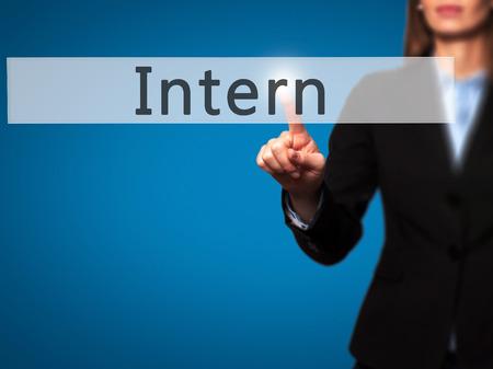 intern: Intern - Businesswoman hand pressing button on touch screen interface. Business, technology, internet concept. Stock Photo
