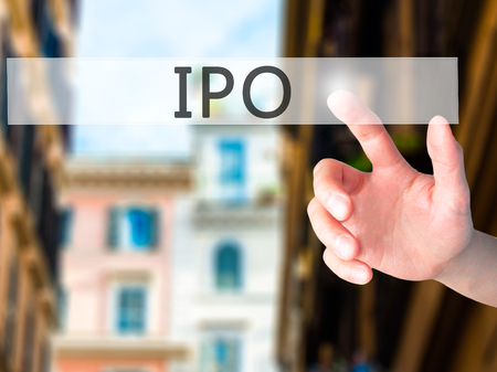 private public: IPO - Hand pressing a button on blurred background concept . Business, technology, internet concept. Stock Photo Stock Photo