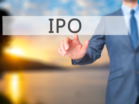 private public: IPO - Businessman hand pressing button on touch screen interface. Business, technology, internet concept. Stock Photo