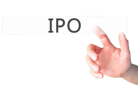 banking problems: IPO - Hand pressing a button on blurred background concept . Business, technology, internet concept. Stock Photo Stock Photo
