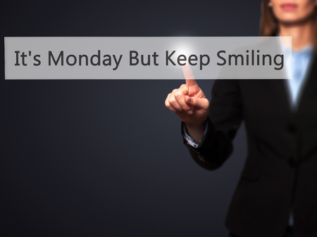 acceptable: Its Monday But Keep Smiling  - Businesswoman hand pressing button on touch screen interface. Business, technology, internet concept. Stock Photo
