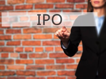 publicly: IPO - Businesswoman hand pressing button on touch screen interface. Business, technology, internet concept. Stock Photo