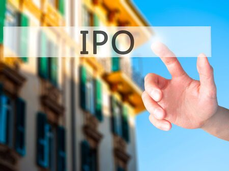 IPO - Hand pressing a button on blurred background concept . Business, technology, internet concept. Stock Photo Stock Photo