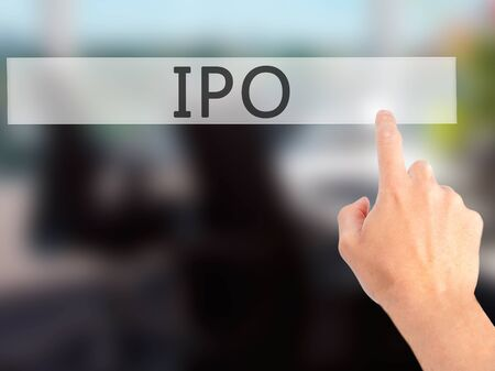 publicly: IPO - Hand pressing a button on blurred background concept . Business, technology, internet concept. Stock Photo Stock Photo