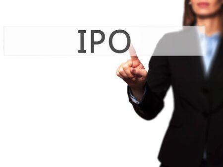 valued: IPO - Businesswoman hand pressing button on touch screen interface. Business, technology, internet concept. Stock Photo
