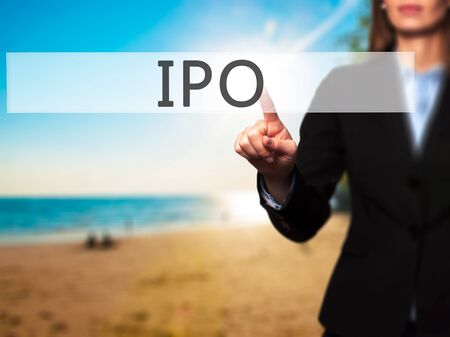 banking problems: IPO - Businesswoman hand pressing button on touch screen interface. Business, technology, internet concept. Stock Photo