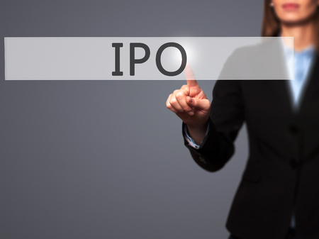 brokerage: IPO - Businesswoman hand pressing button on touch screen interface. Business, technology, internet concept. Stock Photo