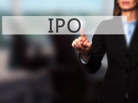 insider: IPO - Businesswoman hand pressing button on touch screen interface. Business, technology, internet concept. Stock Photo