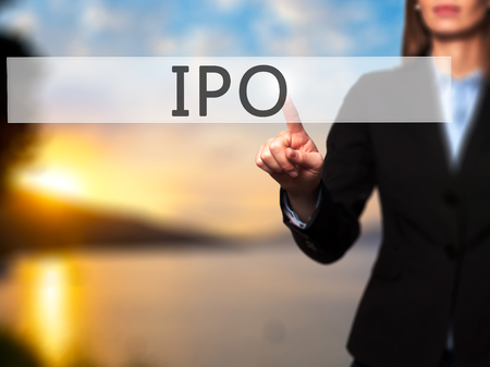 private public: IPO - Businesswoman hand pressing button on touch screen interface. Business, technology, internet concept. Stock Photo