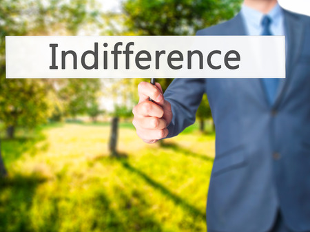 disinterest: Indifference - Businessman hand holding sign. Business, technology, internet concept. Stock Photo