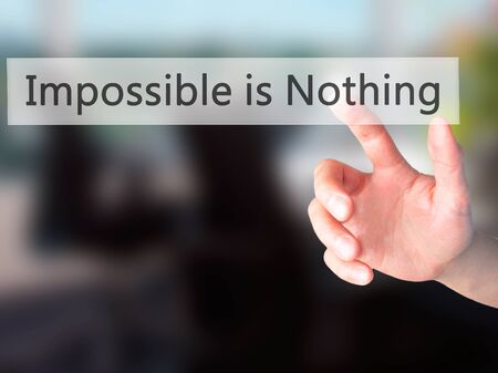 nothing: Impossible is Nothing - Hand pressing a button on blurred background concept . Business, technology, internet concept. Stock Photo Stock Photo