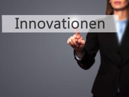 innovator: Innovationen (Innovationin German) - Businesswoman hand pressing button on touch screen interface. Business, technology, internet concept. Stock Photo