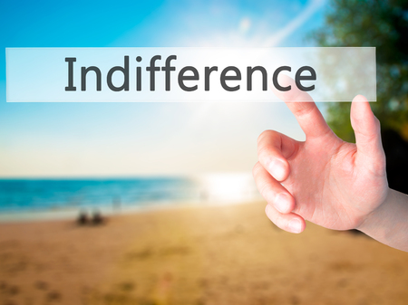 disinterest: Indifference - Hand pressing a button on blurred background concept . Business, technology, internet concept. Stock Photo Stock Photo