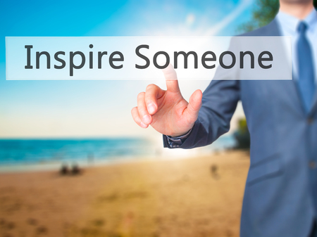 someone: Inspire Someone - Businessman hand pressing button on touch screen interface. Business, technology, internet concept. Stock Photo