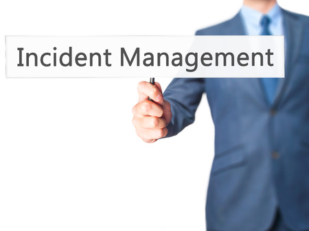 drp: Incident Management - Businessman hand holding sign. Business, technology, internet concept. Stock Photo Stock Photo