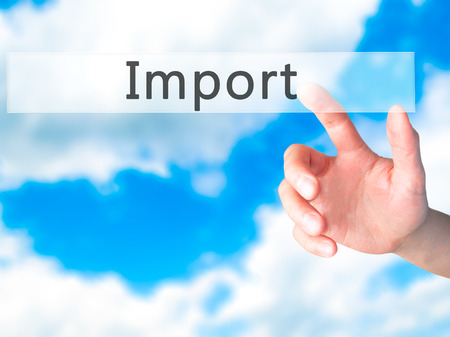 importation: Import - Hand pressing a button on blurred background concept . Business, technology, internet concept. Stock Photo