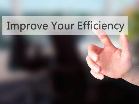 accomplishing: Improve Your Efficiency - Hand pressing a button on blurred background concept . Business, technology, internet concept. Stock Photo Stock Photo