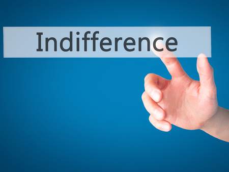 uninterested: Indifference - Hand pressing a button on blurred background concept . Business, technology, internet concept. Stock Photo Stock Photo