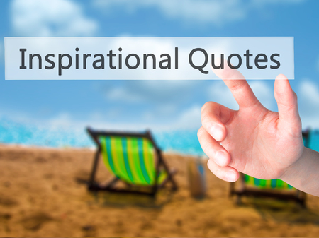 finger proof: Inspirational Quotes - Hand pressing a button on blurred background concept . Business, technology, internet concept. Stock Photo