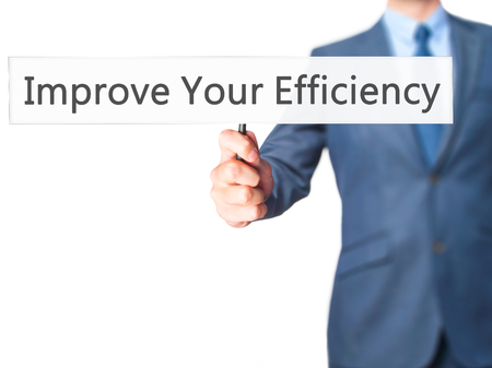 accomplishing: Improve Your Efficiency - Businessman hand holding sign. Business, technology, internet concept. Stock Photo