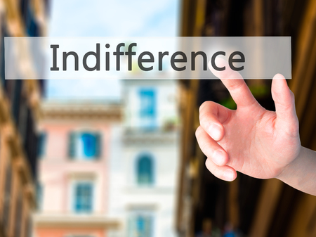 shoulder buttons: Indifference - Hand pressing a button on blurred background concept . Business, technology, internet concept. Stock Photo Stock Photo