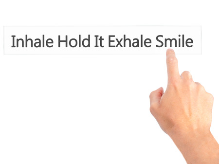 exhale: Inhale Hold It Exhale Smile - Hand pressing a button on blurred background concept . Business, technology, internet concept. Stock Photo Stock Photo