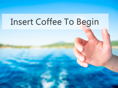 fresh concept: Insert Coffee To Begin - Hand pressing a button on blurred background concept . Business, technology, internet concept. Stock Photo