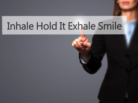 to inhale: Inhale Hold It Exhale Smile - Businesswoman hand pressing button on touch screen interface. Business, technology, internet concept. Stock Photo Stock Photo
