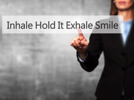 exhale: Inhale Hold It Exhale Smile - Businesswoman hand pressing button on touch screen interface. Business, technology, internet concept. Stock Photo Stock Photo