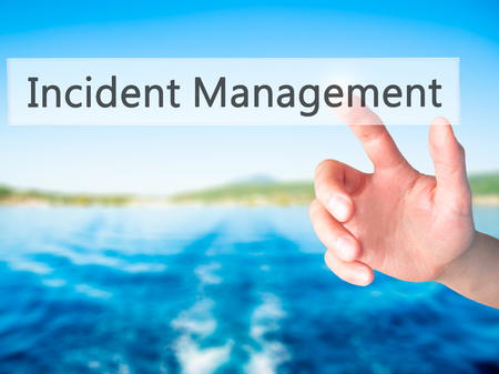 drp: Incident Management - Hand pressing a button on blurred background concept . Business, technology, internet concept. Stock Photo